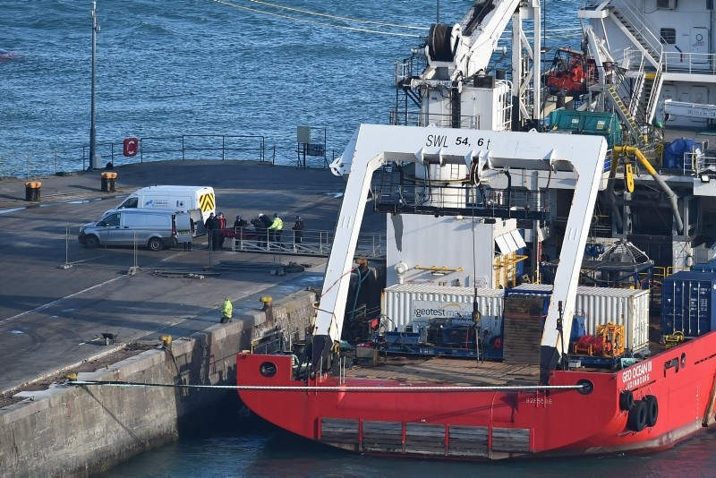 A body is taken off the Geo Ocean III, recovered from the wreckage of a plane carrying Argentine footballer Emiliano Sala at Weymouth harbour, south west England on February 7, 2019. (AFP Photo)