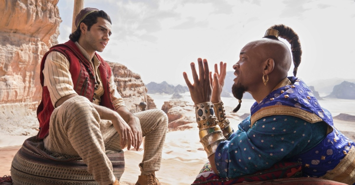 Mena Massoud as Aladdin, (L), and Will Smith as Genie in Disney's live-action adaptation of the 1992 animated classic ,Aladdin.,