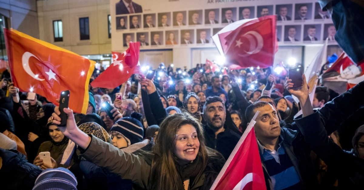 People celebrate the election results in front of the AK Party building in Ankara, April 1, 2019.