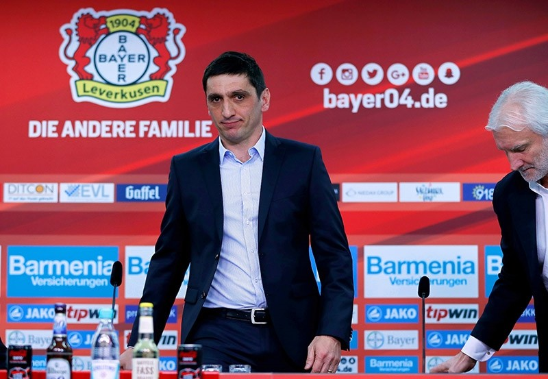Bayer Leverkusen's new head coach Tayfun Korkut (L) and Bayer's sports director Rudi Voeller attend a press conference for Korkut's presentation as new coach of the German Bundesliga soccer club in Leverkusen, Germany, March 06, 2017. (EPA Photo)