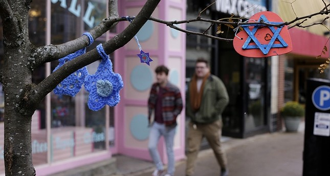 In this Nov. 20, 2018 photo, crafted Stars of David hang from a tree on Forbes Ave in the Squirrel Hill shopping district of Pittsburgh, where the deadliest attack on Jews in the recent history took place in October. (AP Photo)