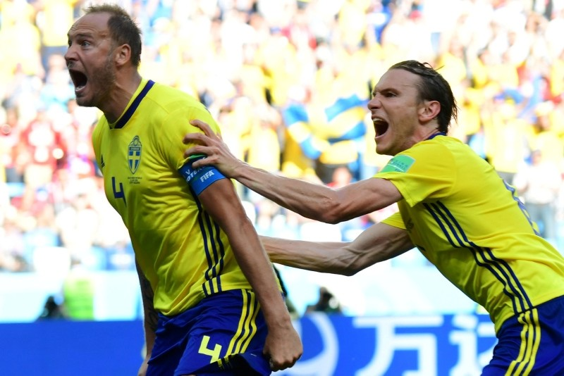 Sweden's defender Andreas Granqvist, left, celebrates after scoring a penalty during the Russia 2018 World Cup Group F football match between Sweden and South Korea at the Nizhny Novgorod Stadium in Nizhny Novgorod, Russia, June 18, 2018. (AFP Photo)