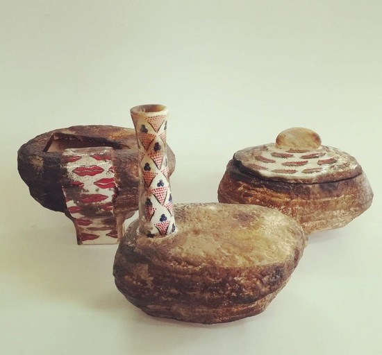 BASE showcases various works including ceramics.