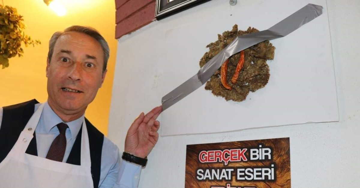 Chef Bahri Dinar points out the fried liver duct-taped to the wall of his restaurant, Edirne, Dec. 17, 2019. (DHA Photo)