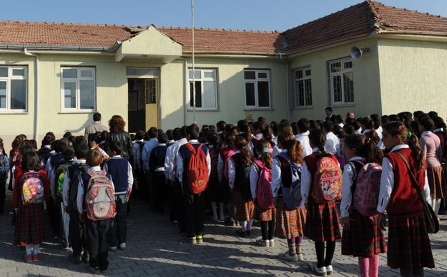 Students gather for the daily routine of reciting the student oath in front of their school, in 2012.
