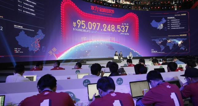 A giant screen showing total sales transacted by e-commerce giant Alibaba on the 'Singles' Day' global online shopping festival in Shenzhen, southern China's Guangdong province.