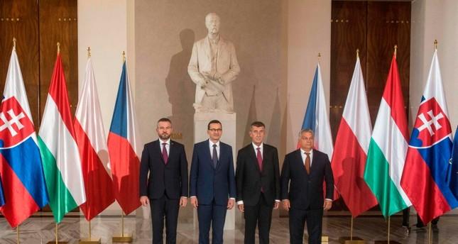 Slovakia's Prime Minister Peter Pellegrini, Polish Prime Minister Mateusz Morawiecki, Czech Prime Minister Andrej Babis and Hungarian Prime Minister Viktor Orban pose for a family photo (AFP Photo)