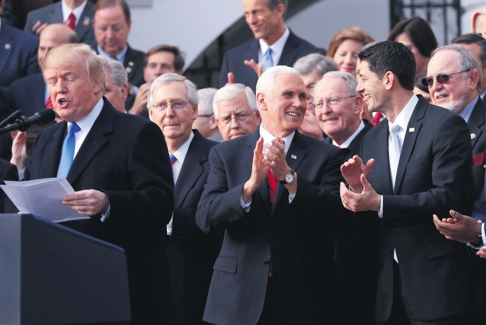 President Trump (L) celebrates with Congressional Republicans after Congress passed sweeping tax overhaul legislation, the White House, Washington, Dec. 20.