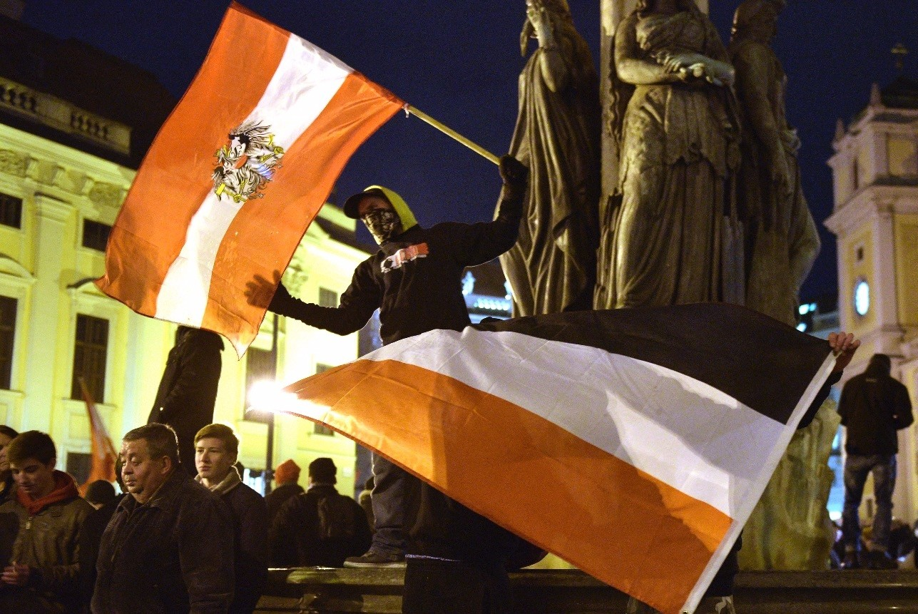 Far-right groups wave flags and display banners during a rally against Islam in Vienna, Austria, Feb. 2, 2015.