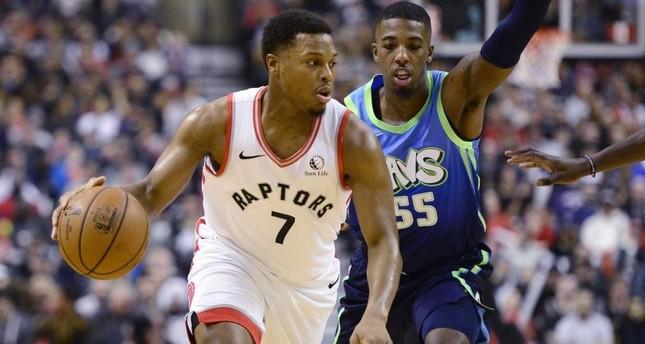 Toronto Raptors' Kyle Lowry 7 dribbles past Dallas Mavericks' Delon Wright 55, Toronto, Dec. 22, 2019. AP Photo