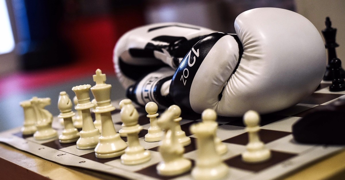 A picture shows a pair of gloves and a chess board during chessboxing training in Paris, Sept. 22, 2019.