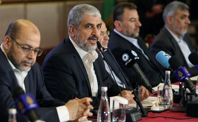 Hamas leader Khaled Mashal announcing the new Hamas policy declaration, Doha, Qatar, May 1.
