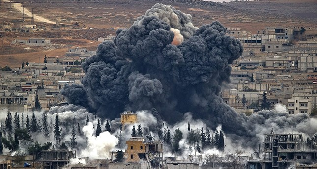 In this Nov. 17, 2014 file photo, smoke rises from the Syrian city of Kobani, following an airstrike by the US led coalition, seen from a hilltop outside Suruç, on the Turkey-Syria border. (AP Photo)