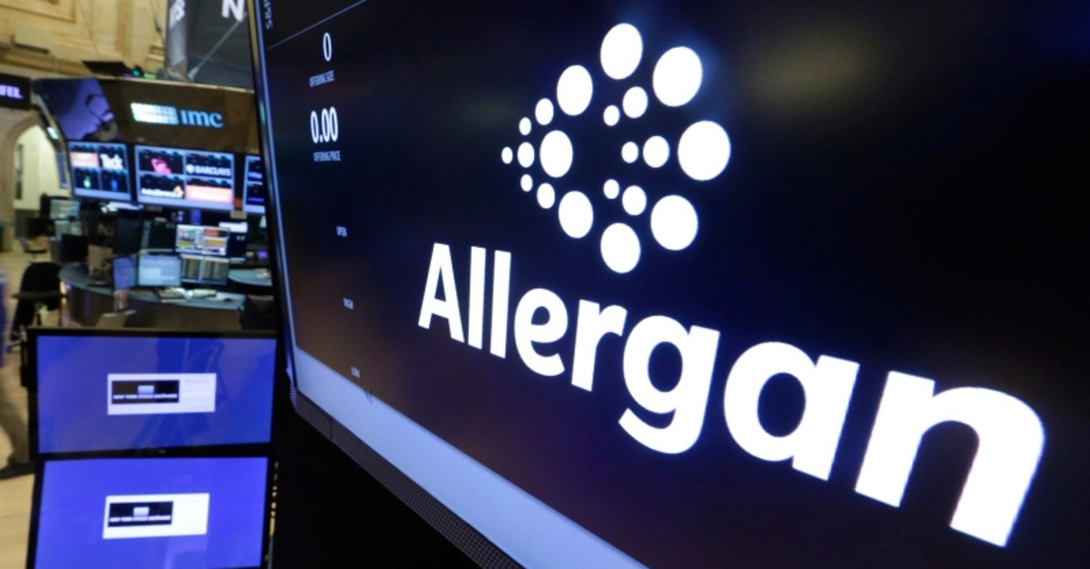In this Monday, Nov. 23, 2015, file photo, the Allergan logo appears above a trading post on the floor of the New York Stock Exchange. (AP Photo)