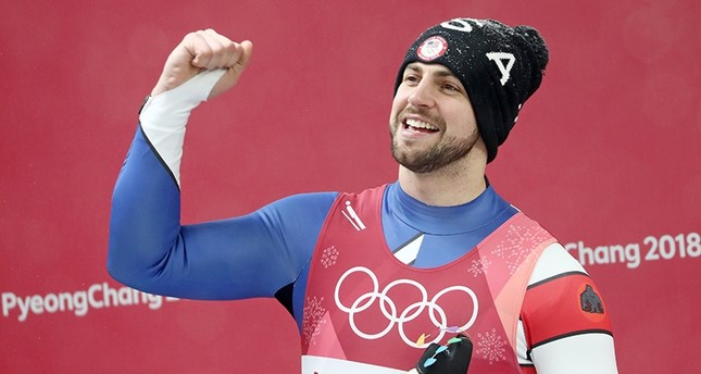 Chris Mazdzer of the USA reacts during the venue ceremony after winning the silver in the Men's Luge Singles competition at the Olympic Sliding Centre during the PyeongChang 2018 Olympic Games, South Korea, Feb. 11, 2018. (EPA Photo)