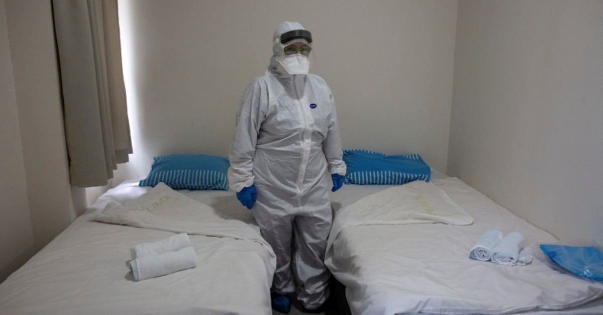 Israeli professor shows one of the rooms where returning Israelis with suspected exposure to coronavirus will stay under observation, at the Chaim Sheba Medical Center at Tel Hashomer in Ramat Gan, Israel, Feb. 19, 2020. (Pool via AP).