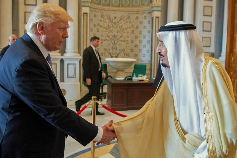 King Salman of Saudi Arabia, right, shaking hands with US President Donald Trump at the opening session of the Gulf Cooperation Council summit in Riyadh, Saudi Arabia, May 21, 2017. (Saudi Press Agency via EPA)