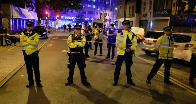 Police cordone off a street in the Finsbury Park area of north London after an attacker drove his van into a group of worshipers at the Muslim Welfare House on Seven Sisters Road, June 19.