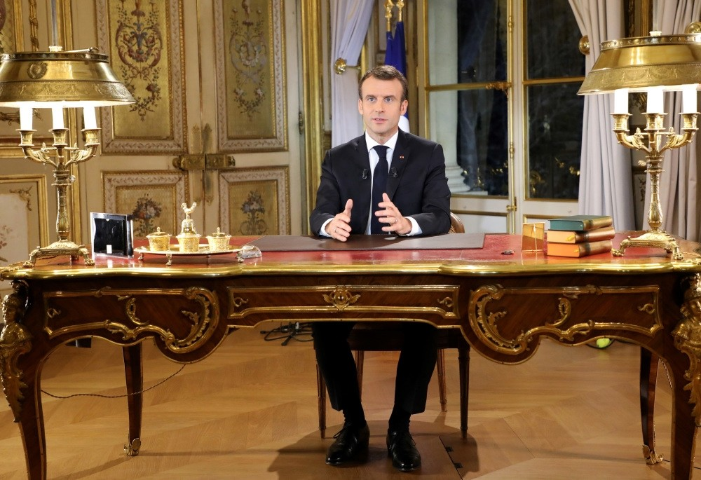 French President Emmanuel Macron poses before a special address to the nation, his first public comments after four weeks of nationwide ,yellow vest, protests, at the u00c9lysu00e9e Palace in Paris, Dec. 10.