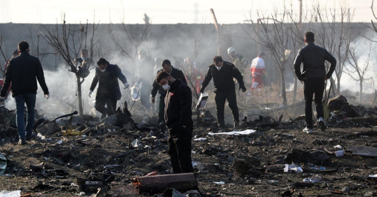 Officials inspect the wreckage after an Ukraine International Airlines Boeing 737-800 carrying 176 people crashed near Imam Khomeini Airport in Tehran, killing everyone on board, in Shahriar, Iran, 08 January 2020.  (EPA-EFE Photo)