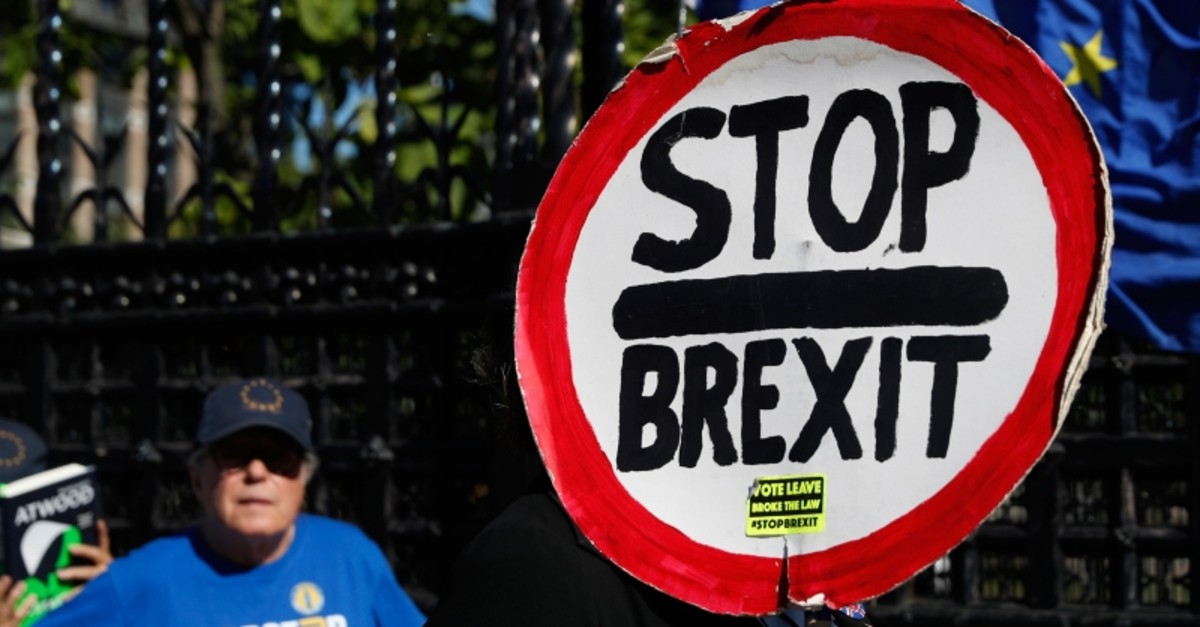 Ani-Brexit protesters demonstrate outside the Houses of Parliament in London, Thursday, Sept. 12, 2019. (AP Photo)