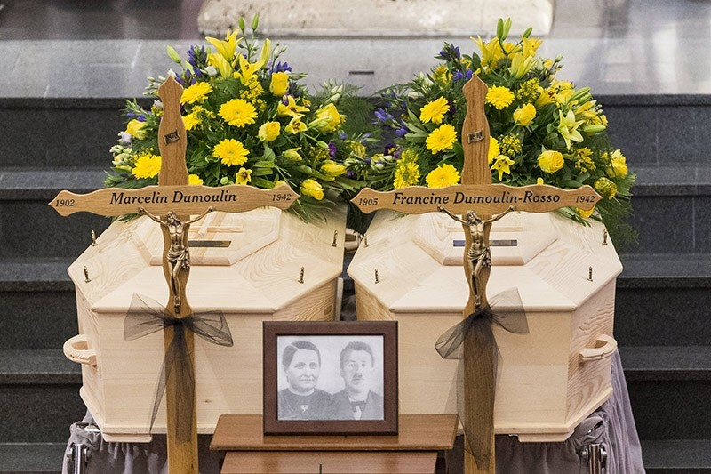 The coffins with the bodies in the church 'Eglise de St-Germain' during the funeral service of Marcelin and Francine Dumoulin in Saviese, Switzerland, 22 July 2017. (EPA Photo)
