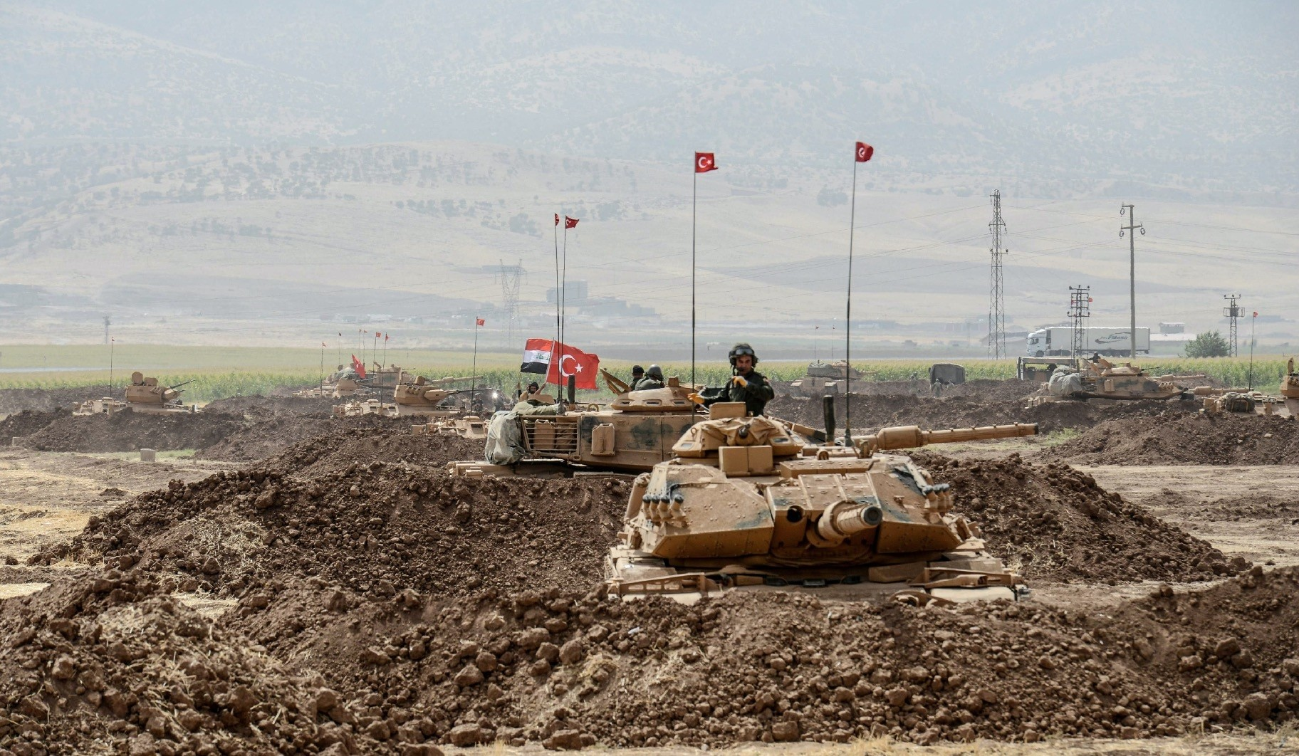 Soldiers drive tanks during a joint military exercise by Turkey and Iraq near the Turkish-Iraqi border in the Silopi district, u015eu0131rnak, Turkey, Sept. 26.