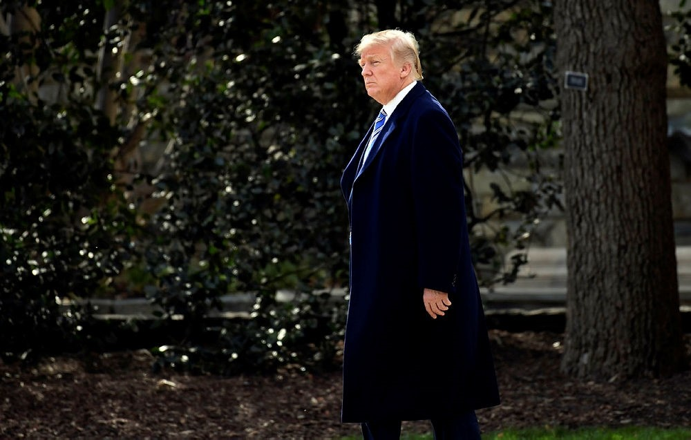 President Donald Trump walks across the South Lawn of the White House in Washington, Friday, March 23, 2018. (AP Photo)
