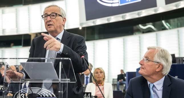 European Commission president Jean-Claude Juncker speaks while European Union chief Brexit negotiator Michel Barnier, right, looks on, Wednesday, Sept. 18, 2019 in Strasbourg, eastern France. AP Photo