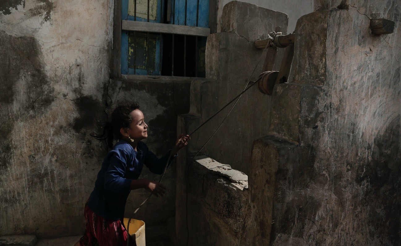 A girl draws water from a well at her home in al-Khoukha, Yemen, Feb. 12.