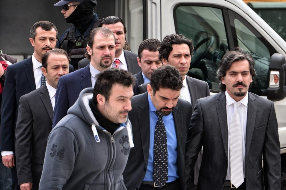 Eight military officers linked to FETu00d6 walk to a Greek courthouse on Jan. 26, 2017, one year after they fled to Greece from Turkey where they participated in a coup attempt.