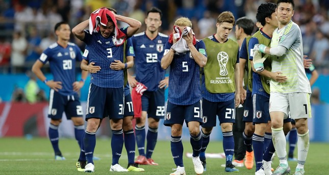 Japan's players walk off the pitch  as they walk on the pitch after losing their round of 16 match between Belgium and Japan at the 2018 World Cup in the Rostov Arena on July 2.