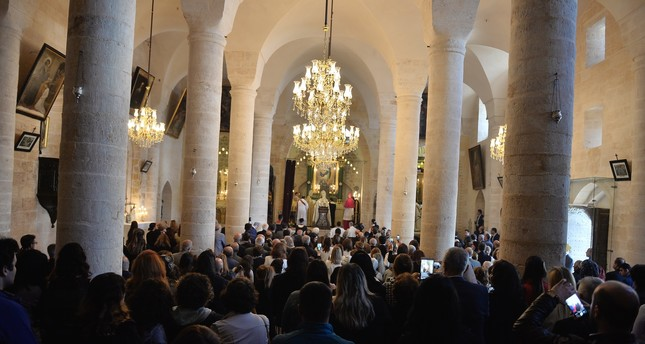 People pray at a Syriac church in Mardin. The city is home to a sizeable Syriac community.