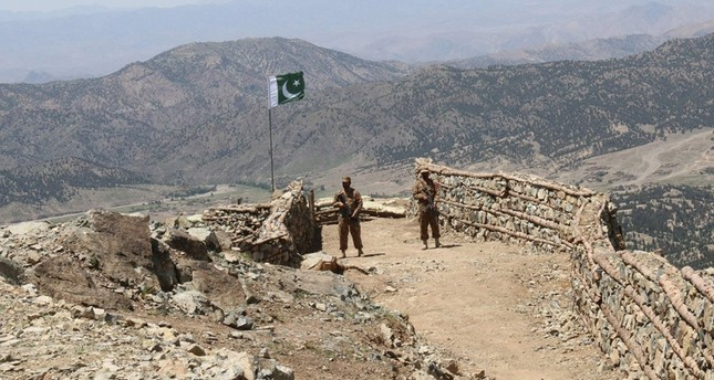 Pakistani soldiers keep vigil from a post on top of a mountain in the former Taliban militants strong hold border area in Shawal valley on May 20, 2016 AFP Photo