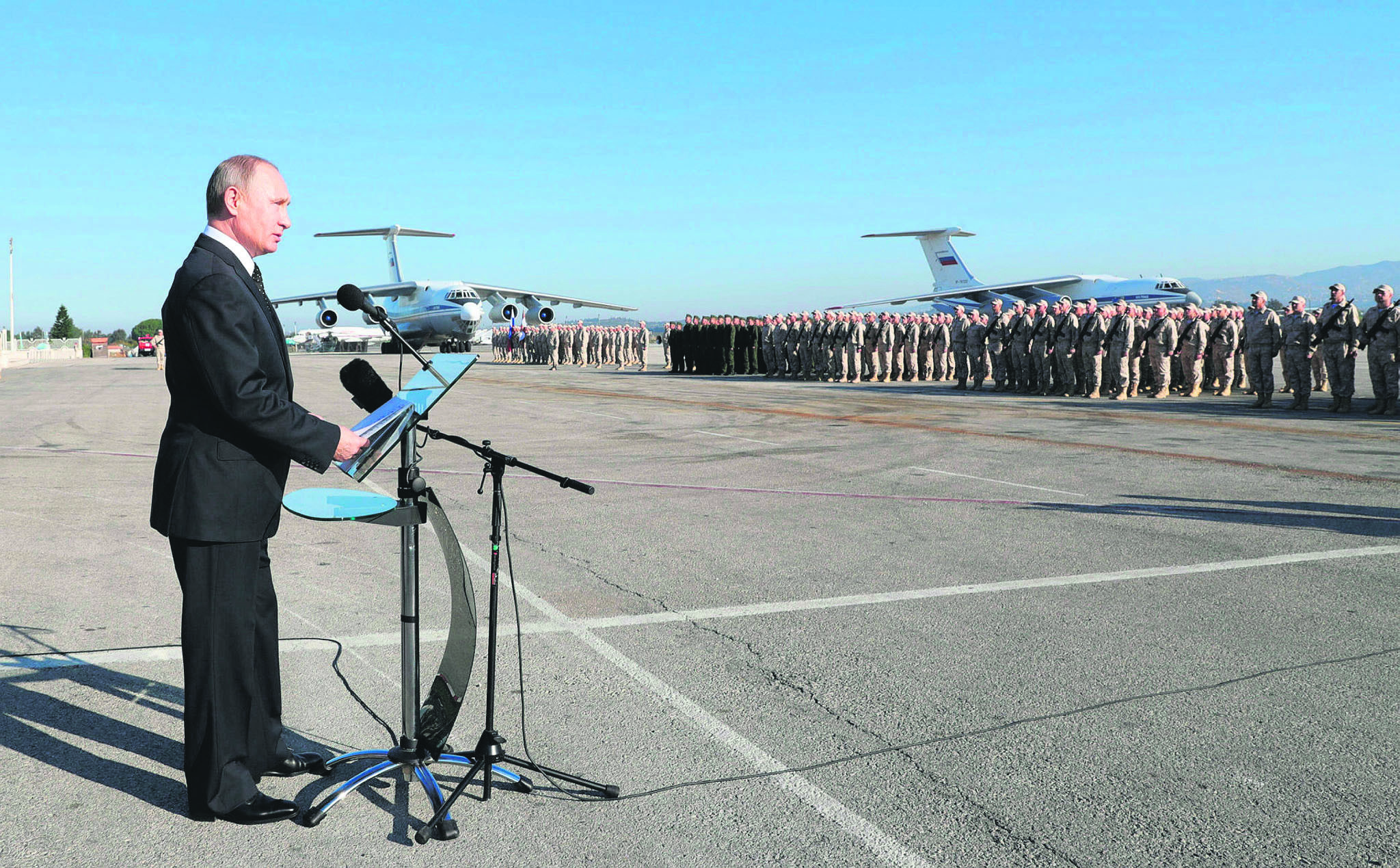 Russian President Putin addresses troops at Hemeimeem Air Base, Syria, Dec. 11.