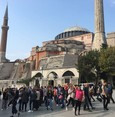 Istanbul benefits from unusually warm weather as tourists flock to historic sites