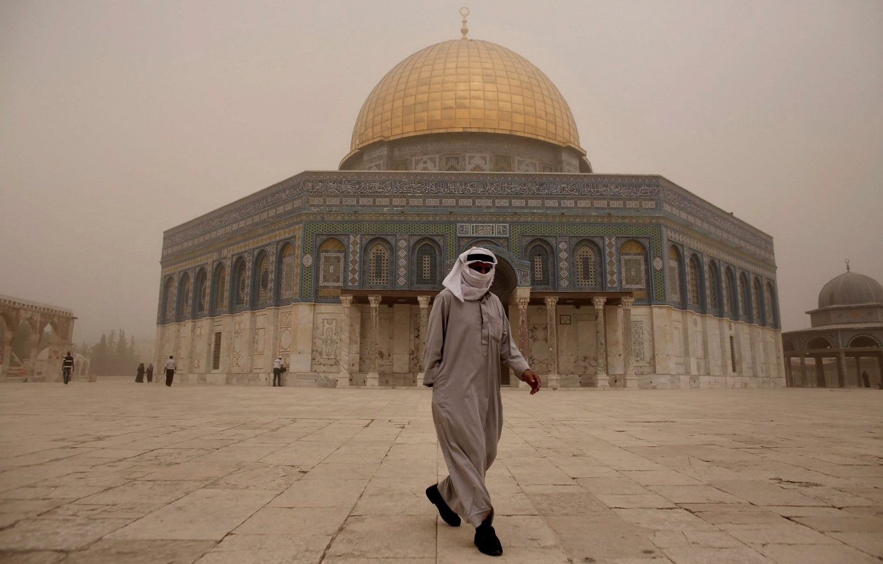 A man walks in the Al-Aqsa compound as a heavy sandstorm hits the Old City of East Jerusalem, Sept. 8, 2015.