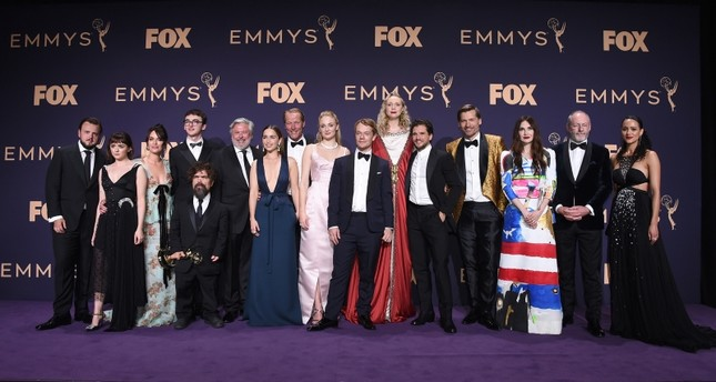 The cast of Game of Thrones, winners of the award for outstanding drama series, pose in the press room at the 71st Primetime Emmy Awards. (AP Photo)