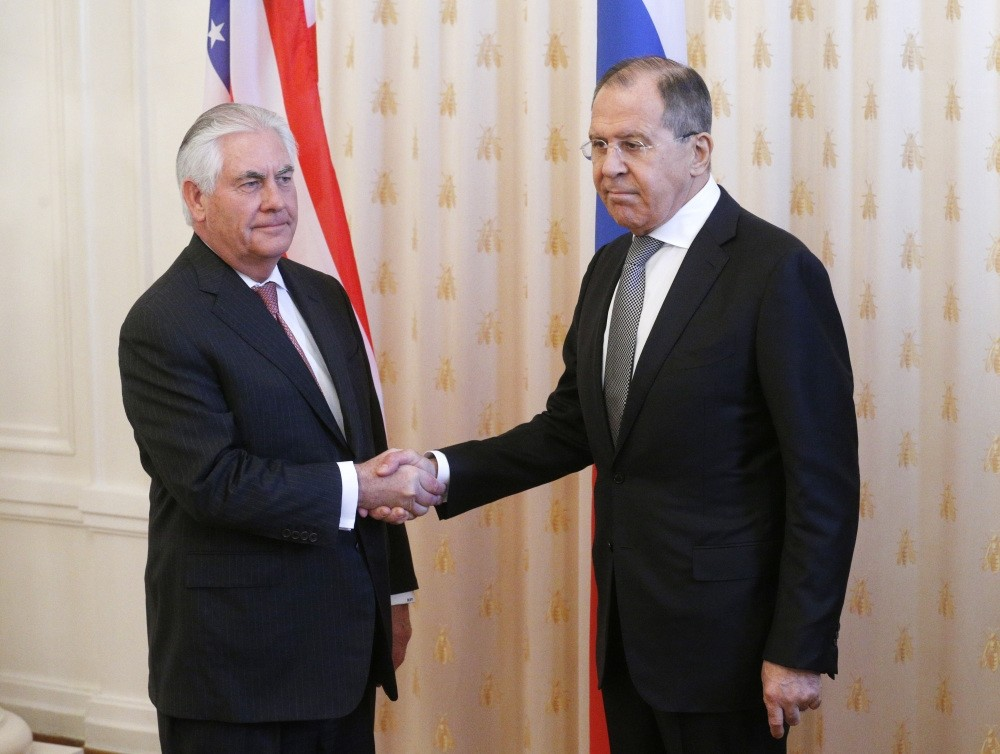 Russian Foreign Minister Sergei Lavrov (R) shakes hands with U.S. Secretary of State Rex Tillerson (L) during their meeting in the Russian Foreign Ministry guest house in Moscow, Russia, April 12.