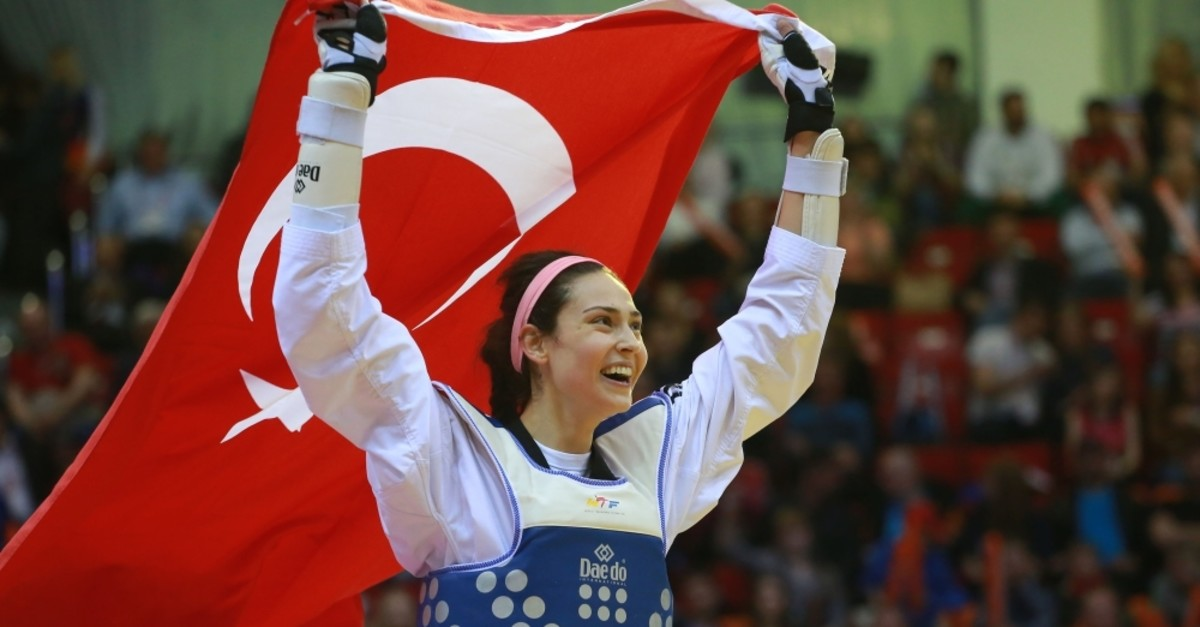 u0130rem Yaman carries the Turkish flag as she celebrates her win at the World Taekwondo Championship in Russia, May 2018.