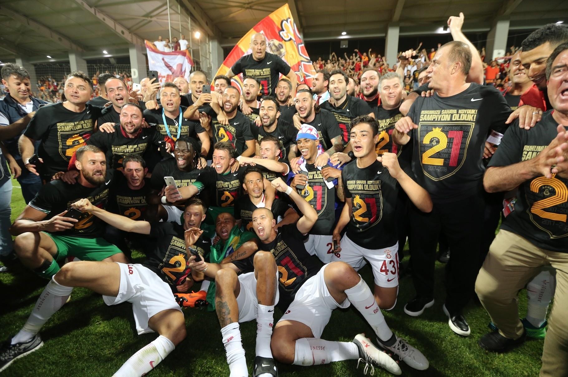 Galatasaray players celebrate winning the Turkish Super League title.