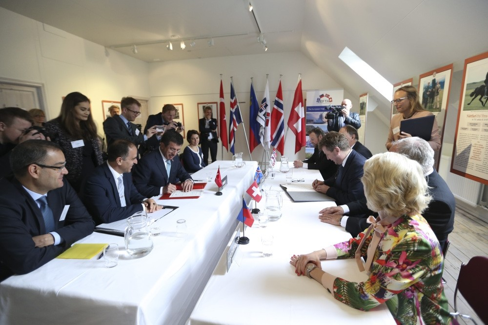 Economy Minister Nihat Zeybekci (third from left) at the signing ceremony of the expanded and modernized free trade agreement (FTA) with the European Free Trade Association (EFTA), Saudarkrokur, Iceland, yesterday.