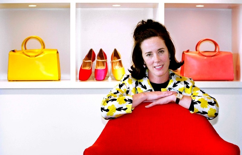 In this May 13, 2004 file photo, designer Kate Spade poses with handbags and shoes from her next collection in New York. (AP Photo)