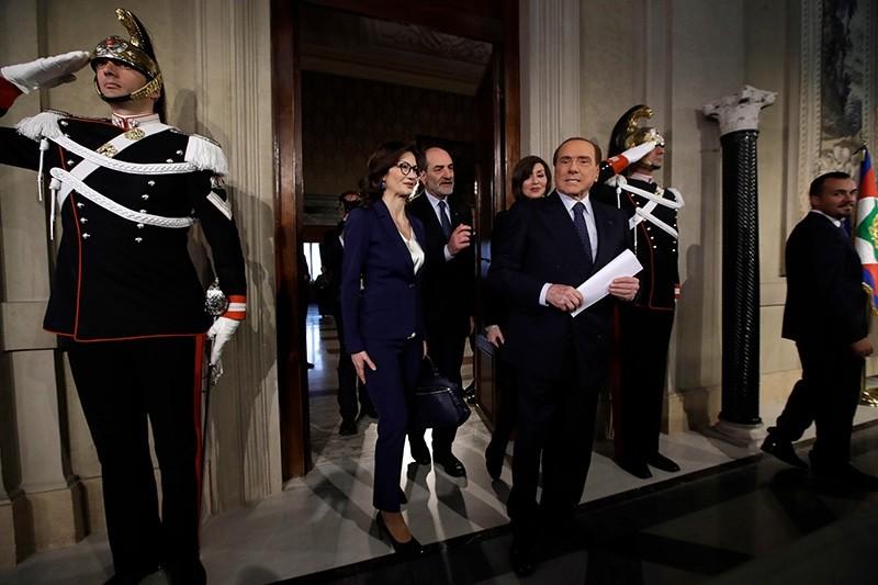 Forza Italia leader Silvio Berlusconi, right, followed by Mariastella Gelmini, left, and Anna Maria Bernini, second from right, arrive to meet journalists after talks with  Italian President Sergio Mattarella, in Rome, April 5, 2018. (AP Photo)