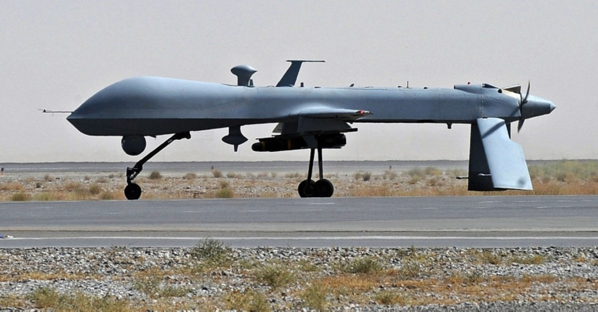 A file picture taken on June 13, 2010 shows a US Predator unmanned drone armed with a missile on the tarmac of Kandahar military airport in Afghanistan. (AFP Photo)