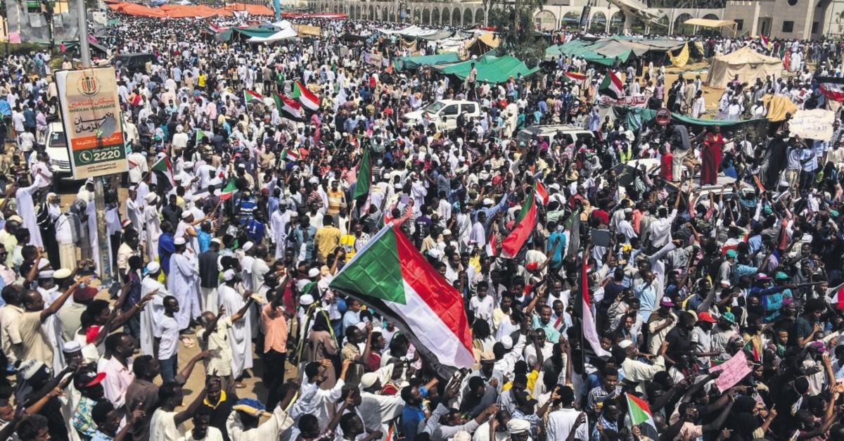 Demonstrators rally against military rule in Sudan's capital, Khartoum, April 12, 2019.