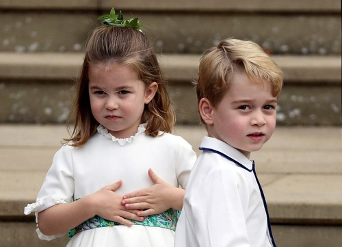 Prince George and Princess Charlotte arrive for the the wedding of Princess Eugenie of York and Jack Brooksbank. (AP Photo)