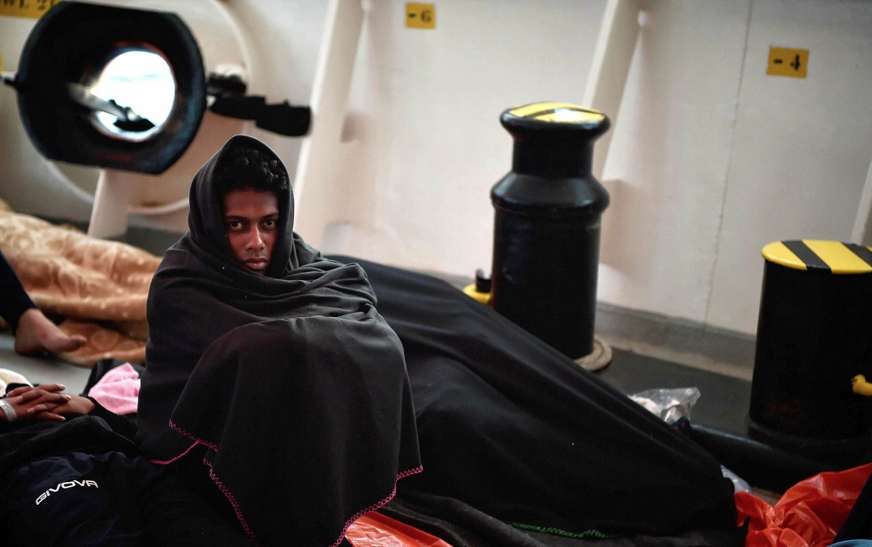 A migrant sits onboard a rescue vessel chartered by SOS-Mediterranu00e9e and Doctors Without Borders (MSF), some 30 nautical miles off Libya coast, May 8.