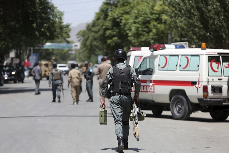 Afghan security personnel inspect at the site of a suicide attack, in the center of Kabul, Afghanistan, Wednesday, May 9, 2018. (AP Photo)