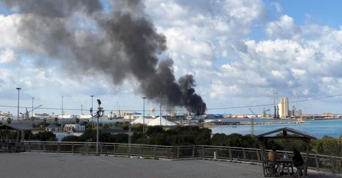 Smoke rises from the port of Libyan capital Tripoli after being attacked by eastern Libya based forces of Khalifa Haftar, on Feb 18, 2020. (Reuters Photo)